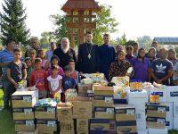 Solidaritate: 7 tone de alimente pentru persoane defavorizate din Parohia Cojasca!